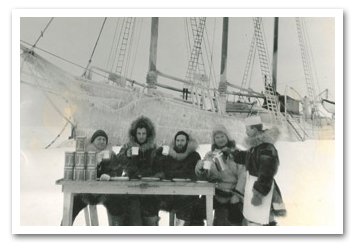 Alaskan explorers drinking Hills Bros coffee